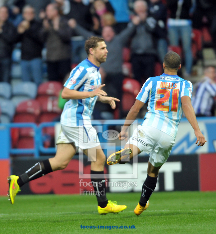Grant Holt (left) of Huddersfield Town scores a 3rd goal against Nottingham Forest during the Sky Bet Championship match at the John Smiths Stadium, Huddersfield<br /> Picture by Graham Crowther/Focus Images Ltd +44 7763 140036<br /> 01/11/2014
