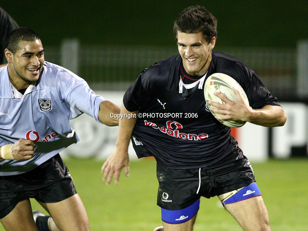 Todd Byrne races away from Constantine Mika at the Warriors training session held at Ericsson Stadium, Auckland, New Zealand, on Wednesday 17 May, 2006. Photo: Andrew Cornaga/PHOTOSPORT<br />