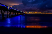 Combination of Christmas lights and Sunrise reflected in the Ocean at Sunrise in Deerfield Beach