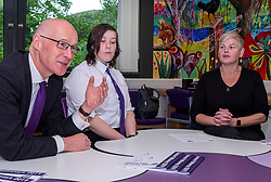 Pictured: John Swinney, Erin Rice and her mother Ann Marie<br /><br />The Deputy First Minister visited Holy Rood High School in Edinburgh today to meet parents and pupils before announcing GBP50 million funding for improving attainment.  The results of a survey of headteachers were also published during the Deputy First Minister's visit.<br /><br /> Ger Harley | EEm 30 May 2019