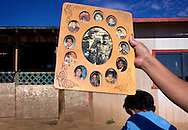 """Sharon Williams holds a family photo of her parents, Mark and Annie Tsosie surrounded by their children, who were all raised without running water. """"People in Phoenix have it made. They have water for grass, they can step in a shower any time they want, they never have to wonder if they have water,"""" said Williams.  """"If they had to come up here and live like us for a day,"""" she said, with only a trace of taunting in her voice, """"they wouldn't make it.""""."""