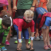 Children stretch before the Super Hero Fun Run Saturday July 26, 2014 at the Myrtle Grove Library in Wilmington, N.C. (Jason A. Frizzelle)