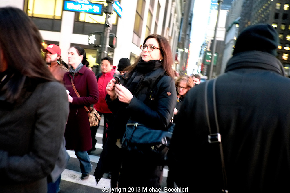 NEW YORK, NY - February 07:  A woman walks in Times Square on February 07, 2013 in NEW YORK, NY.  (Photo by Michael Bocchieri/Bocchieri Archive)