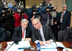 Jean-Claude Trichet, president of the European Central Bank, left, speaks with Olli Rehn, The EU's economic and monetary affairs commissioner, during an emergency meeting of euro zone finance ministers in Brussels, on Sunday, May 2, 2010. Greece accepted an unprecedented bailout from the European Union and International Monetary Fund worth more than 110 billion euros ($146 billion). (Photo © Jock Fistick)