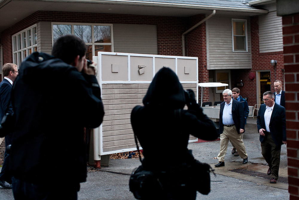 Republican presidential candidate Newt Gingrich walks to his bus after speaking at a campaign event at the Wakonda Club on Friday, December 30, 2011 in Des Moines, IA.