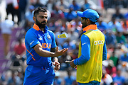 Virat Kohli (captain) of India tosses a yellow tube in the air during the drinks break during the ICC Cricket World Cup 2019 match between India and Afghanistan at the Ageas Bowl, Southampton, United Kingdom on 22 June 2019.
