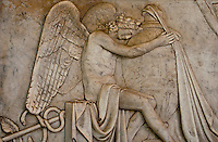 Detail of a bas relief marble sculpture of an angel in a cemetery on Isola San Michel in Venice, Italy.