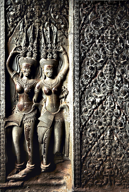 Angkor Wat, closeup of two Apsara dancers and panel of foliage ornament.