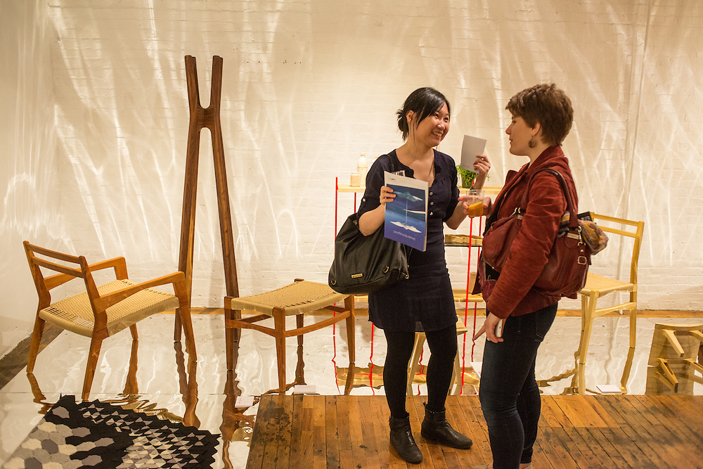 Fair attendees chat among furniture in the room devoted to design and designers from Mexico.