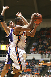 Virginia guard J.R. Reynolds (2) beats a Northwestern defender as he prepares to shoot the ball in the second half.  Reynolds had 13 points in the game to help UVA win their portion of the 2005 ACC/BigTen Challenge...The Virginia Cavaliers Men's Basketball team defeated the Northwestern Wildcats 72-57 in the ACC/BigTen Challenge at University Hall in Charlottesville, VA on November 30, 2005..