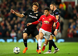 Alexis Sanchez of Manchester United goes past Pablo Sarabia and Franco Vazquez of Sevilla - Mandatory by-line: Robbie Stephenson/JMP - 13/03/2018 - FOOTBALL - Old Trafford - Manchester, England - Manchester United v Sevilla - UEFA Champions League Round of 16 2nd Leg