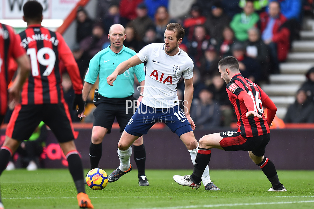 Harry Kane (10) of Tottenham Hotspur being challenged by Lewis Cook (16) of AFC Bournemouth during the Premier League match between Bournemouth and Tottenham Hotspur at the Vitality Stadium, Bournemouth, England on 11 March 2018. Picture by Graham Hunt.