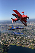 Flying inverted in the foreground, aerobatic Pilot Sean D. Tucker flies his Oracle Challenger III with Blue Angel pilots Lt. Dave Tickle in #6 and Lt. C. J. Simonsen in #5, center, over the Seattle skyline. (Greg Gilbert  The Seattle Times)