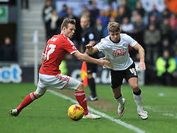 Derby County's Jamie Ward breaks away from Nottingham Forest's Todd Kane - Photo mandatory by-line: Dougie Allward/JMP - Mobile: 07966 386802 - 17/01/2015 - SPORT - Football - Derby - iPro Stadium - Derby County v Nottingham Forest - Sky Bet Championship