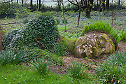 Mud Maid earth woman sculpture of stone and plants at the Lost Gardens of Heligan tourist attraction, Cornwall, England