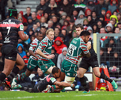 Manu Tuilagi of Leicester is tackled by Gael Fickou during the Heineken Cup match between Stade Toulouse and Leicester Tigers at Stade Municipal on October 14, 2012 in Toulouse, France. Eoin Mundow/Cleva Media