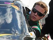 Nov. 12 2011; Avondale, AZ, USA; NASCAR Nationwide Series driver Trevor Bayne (13) climbs into his car during qualifying for the Wypall 200 at Phoenix International Raceway. Mandatory Credit: Jennifer Stewart-US PRESSWIRE