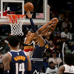 Jan 30, 2019; New Orleans, LA, USA; Denver Nuggets guard Will Barton (5) is fouled by New Orleans Pelicans center Jahlil Okafor (8) during the second half at the Smoothie King Center. Mandatory Credit: Derick E. Hingle-USA TODAY Sports