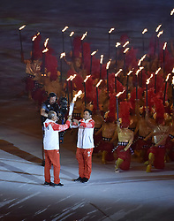 JAKARTA, Aug. 18, 2018  Torchbearers hand over the torch at the Gelora Bung Karno (GBK) Main Stadium during the opening ceremony of the 18th Asian Games in Jakarta, Indonesia, Aug. 18, 2018. (Credit Image: © Li He/Xinhua via ZUMA Wire)