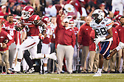 FAYETTEVILLE, AR - OCTOBER 31:  Alex Collins #3 of the Arkansas Razorbacks outruns Logan Burns #28 of the UT Martin Skyhawks for a touchdown at Razorback Stadium on October 31, 2015 in Fayetteville, Arkansas.  The Razorbacks defeated the Skyhawks 63-28.  (Photo by Wesley Hitt/Getty Images) *** Local Caption *** Alex Collins; Logan Burns