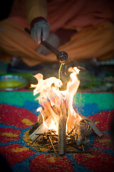 "© under license to London News pictures.  06/11/2010.Ghee being poured over a fire during Celebrations for Diwali, the Hindu new year, at Gokul Centre for Cow Protection and Working Oxen in Aldenham near Watford, Hertfordshire today (Sat). The centre, which was originally donated by George Harrison, is unique in the western world producing ""Ahimsa Milk"" at a cost of £3 per litre without harm to any living being. The Centre is part of Bhaktivedanta Manor, a Hindu place of worship."