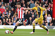 Brentford striker, Scott Hogan (9) scoring Brentford second goal 2-0 during the Sky Bet Championship match between Brentford and Fulham at Griffin Park, London, England on 30 April 2016. Photo by Matthew Redman.