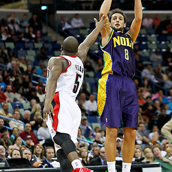 February 10, 2012; New Orleans, LA, USA; New Orleans Hornets shooting guard Marco Belinelli (8) shoots over Portland Trail Blazers point guard Raymond Felton (5) during the first half of a game at the New Orleans Arena.   Mandatory Credit: Derick E. Hingle-US PRESSWIRE