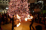 Adam Weisgerber (left) and Tony Steinbach perform in front of the newly lit tree during the Grande Illumination & Dayton Children's Parade Spectacular in Lights which begins the 39th Annual Dayton Holiday Festival in Courthouse Square in downtown Dayton, Friday, November 25, 2011.