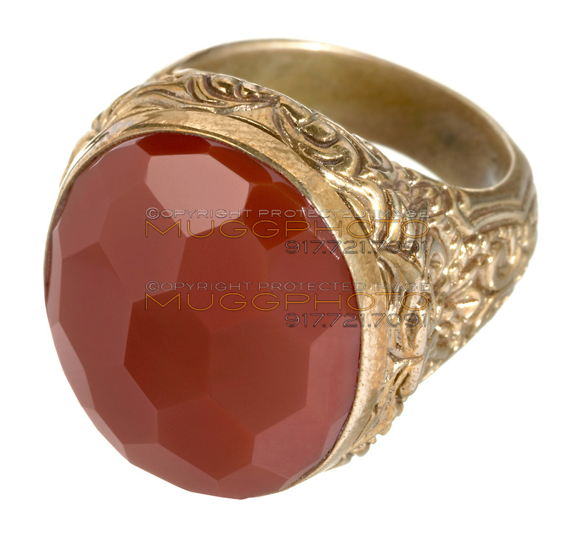 large red stone ring on a gold setting