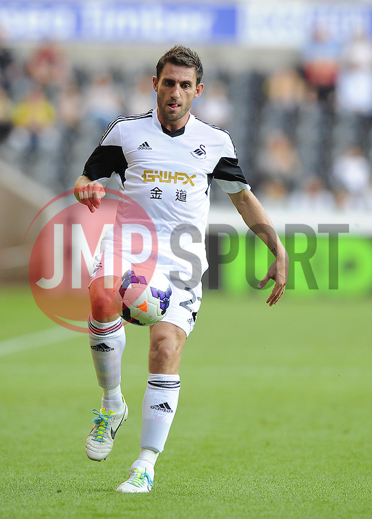 "Swansea City's Angel Rangel  - Photo mandatory by-line: Joe Meredith/JMP - Tel: Mobile: 07966 386802 22/08/2013 - SPORT - FOOTBALL - Liberty Stadium - Swansea -  Swansea City V Petrolul Ploiesti - Europa League Play-Off EDITORIAL USE ONLY. No use with unauthorised audio, video, data, fixture lists, club/league logos or ""live"" services. Online in-match use limited to 45 images, no video emulation. No use in betting, games or single club/league/player publications"