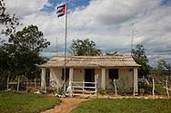 Building with flag near Santa Lucia, Pinar del Rio, Cuba.
