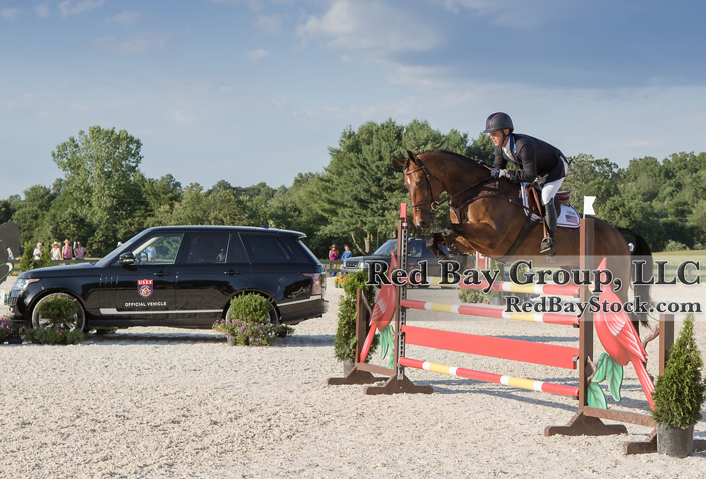 Clark Montgomery riding Loughan Glen competes in the Show Jumping phase at the 2016 Land Rover Great Meadow International on Saturday, July 9, 2016, at the Great Meadow Foundation in The Plains, VA with the 2016 Range Rover in the background.