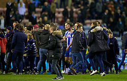 WIGAN, ENGLAND - Monday, February 19, 2018: Wigan Athletic's match-winning goal-scorer Will Grigg celebrates with supporters after beating Manchester City 1-0 in the FA Cup 5th Round match between Wigan Athletic FC and Manchester City FC at the DW Stadium. (Pic by David Rawcliffe/Propaganda)