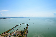 Nederland, Friesland, Kornwerderzand, 05-08-2014; Afsluitdijk met sluizencomplex. Links Fries kust, rechts IJsselmeer.  <br /> <br /> Enclosure Dam near the Frisian coast. Sluices and locks. IJsselmeer right.<br /> luchtfoto (toeslag op standaard tarieven);<br /> aerial photo (additional fee required);<br /> copyright foto/photo Siebe Swart.