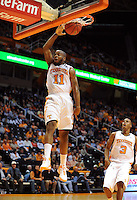 Nov 03, 2011; Knoxville, TN, USA; Tennessee Volunteers guard Trae Golden (11) dunks the ball against the Carson Newman Eagles during the first half at Thompson Boling Arena. Mandatory Credit: Randy Sartin-US PRESSWIRE