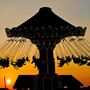 A silhouette of the swing ride at Jenkinson's Pier in Point Pleasant, NJ