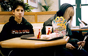 Two teenagers sitting in Mcdonalds, Camden Town London UK 2001