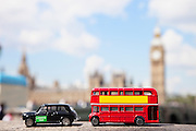 Public transport figurines with Big Ben Tower in the background