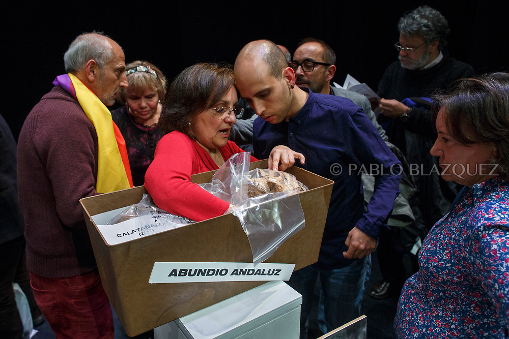 14/04/2018. Granddaughter Ana Maria and other relatives check the items of a coffin containing the remains of victim of Spain Civil War Abundio Andaluz during a homage to hand the remains of victims of Spain's Civil War exhumed in Cobertelada and Calata&ntilde;azor to their relatives at the Centro Cultural Palacio de la Audiencia on April 14, 2018 in Soria, Spain. La Asociacion Soriana Recuerdo y Dignidad (ASRD) 'The Soria Association for Memory and Dignity' celebrated a tribute to hand over the remains of civil war victims to their families. The Society of Sciences of ARANZADI helped with the research, exhumation and identification of the bodies, after villagers passed the information about the mass grave, 81 years after the assassination took place, to the ASRD. Seven people were assassinated around August 25, 1936 by Falangists, as part of General Francisco Franco armed forces, and buried in the 'Fosa de los Maestros' (Teachers Mass Grave) near Cobertelada, Soria, after being taken from prison of Almazan during the Spanish Civil War. Five of them were teachers in the region, and also friends of Spanish writer Antonio Machado. The other two still remain unidentified. Another body was assassinated by Falangists accompanied by a priest in 1936, and was exhumed on 23 September of 2017 near Calata&ntilde;azor, Soria. It belonged to Abundio Andaluz, a politician, lawyer and musician in Soria.<br /> Spain's Civil War took the lives of thousands of people on both sides, and civilians. But Franco continued his executions after the war has finished. Teachers, as part of the education sector, were often a target of Franco's forces. Spanish governments has never done anything to help the victims of the Civil War and Franco's dictatorship while there are still thousands of people missing in mass graves around the country. (&copy; Pablo Blazquez)