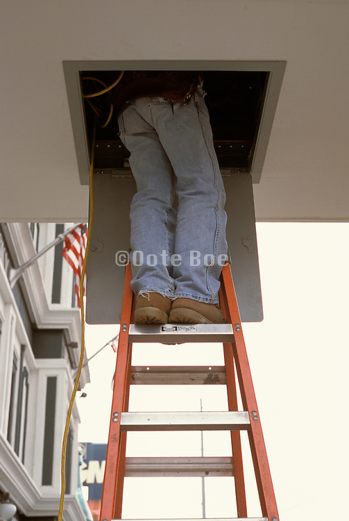 repairman on ladder