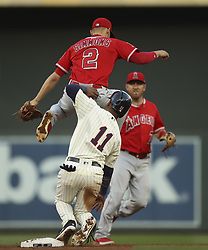 July 5, 2017 - Minneapolis, MN, USA - Los Angeles Angels shortstop Andrelton Simmons (2) and the Minnesota Twins' Jorge Polanco (11) collide at second after Polanco was forced out to end the fourth inningon Wednesday, July 5, 2017, at Target Field in Minneapolis. (Credit Image: © Jeff Wheeler/TNS via ZUMA Wire)