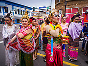 "29 APRIL 2017 - MINNEAPOLIS, MINNESOTA: People in traditional Thai costumes prepare for the parade at Songkran Uptown. Several thousand people attended Songkran Uptown on Hennepin Ave in Minneapolis for the city's first celebration of Songkran, the traditional Thai New Year. Events included a Thai parade, a performance of the Ramakien (the Thai version of the Indian Ramayana), a ""Ladyboy"" (drag queen) show, and Thai street food.     PHOTO BY JACK KURTZ"