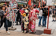 Japanese women in kimonos in Asakusa district, Tokyo, Japan.