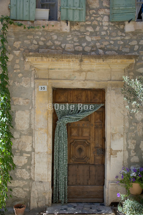 door with curtain in a small village South France