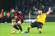 Diego Rico (21) of AFC Bournemouth and Wolverhampton Wanderers defender Matt Doherty (2) during the Premier League match between Wolverhampton Wanderers and Bournemouth at Molineux, Wolverhampton, England on 15 December 2018.