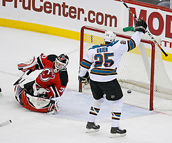 February 20, 2008; Newark, NJ, USA;  San Jose Sharks right wing Mike Grier (25) celebrates a goal by San Jose Sharks defenseman Kyle McLaren (4) on New Jersey Devils goalie Martin Brodeur (30) during the third period at the Prudential Center in Newark, NJ.  The Devils beat the Sharks 3-2.