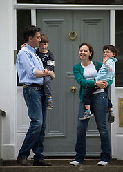 © London News Pictures. 09/05/2015. Former Labour Party Leader Ed Miliband and His wife Justine Thornton holding their sons Daniel (held by David) and Samuel (held by Justine) as they pose for a photograph outside their home, following a heavy loss in the general election on Thursday.  Photo credit: Ben Cawthra. Photo credit: Ben Cawthra/LNP