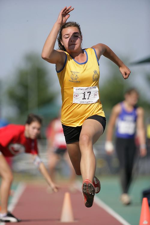 (Sherbrooke, Quebec -- 9 Aug 2009)  Danielle Kabatoff of Alberta competes in triple jump at the 2009 Legion Youth National Track and Field Championships. Photograph copyright Sean Burges / Mundo Sport Images  2009.