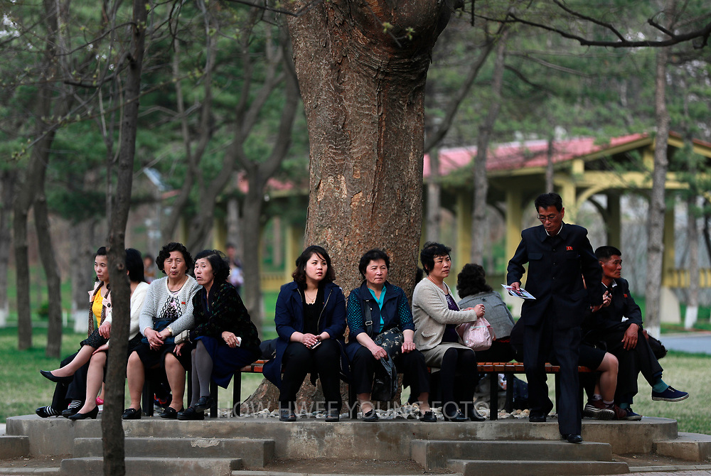 A picture made available on 17 April 2017 of North Koreans resting in the Central Zoo in Pyongyang, North Korea, 16 April 2017. A North Korean missile exploded within seconds of its launch on the east coast on 16 April, South Korean and US officials say as tensions rise in the region over nuclear issues.
