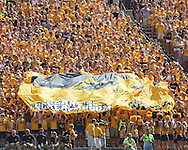 August 31 2013: Fans in the Iowa Hawkeyes student section wave a large banner with a logo after a score during the first quarter of the NCAA football game between the Northern Illinois Huskies and the Iowa Hawkeyes at Kinnick Stadium in Iowa City, Iowa on August 31, 2013. Northern Illinois defeated Iowa 30-27.